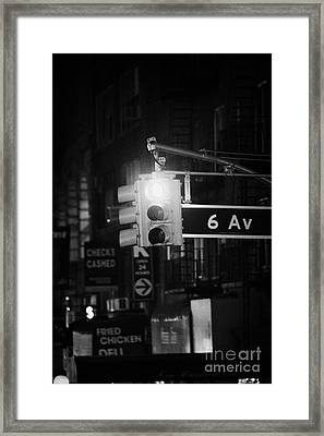 red traffic stop sign on 6th Avenue at night new york city Framed Print by Joe Fox