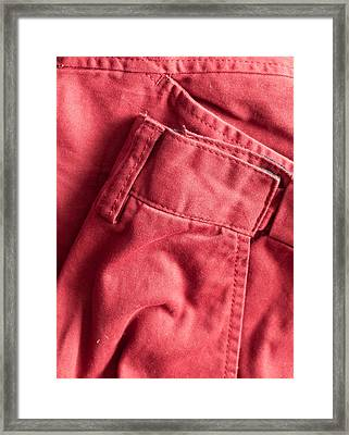 Red Trousers Framed Print by Tom Gowanlock