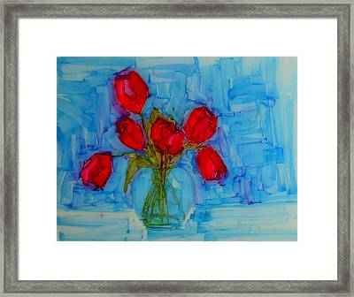 Red Tulips With Blue Background Framed Print by Patricia Awapara