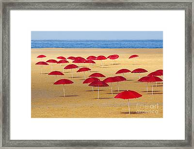 Red Umbrellas Framed Print by Carlos Caetano
