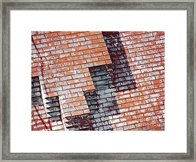 Red Wall Framed Print by Sarah Loft