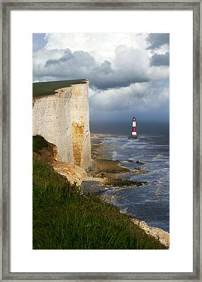 White Cliffs And Red-white Striped Lightouse In The Sea Framed Print by Jaroslaw Blaminsky