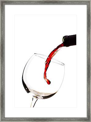 Red Wine Poured Into Wineglass Framed Print