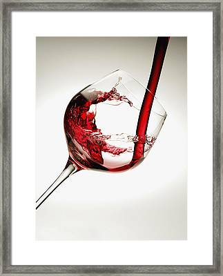 Red Wine Pouring Into A Glass Framed Print by Richard Desmarais