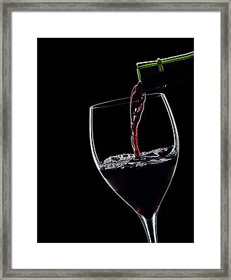 Red Wine Pouring Into Wineglass Splash Silhouette Framed Print by Alex Sukonkin