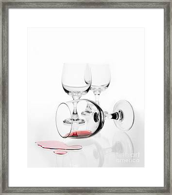 Overturned Wine Glass With Red Wine Splashed Out  Framed Print by Arletta Cwalina