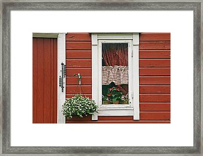 Red Wooden House With Plants In And By Framed Print by Chris Parker