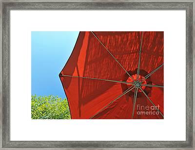 Reddish Umbrella Against Blue Sky Framed Print by Sami Sarkis