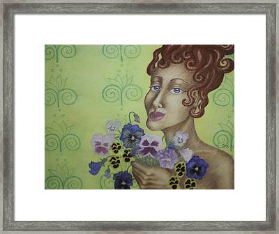 Redhead Holding Pansies Framed Print by Claudia Cox