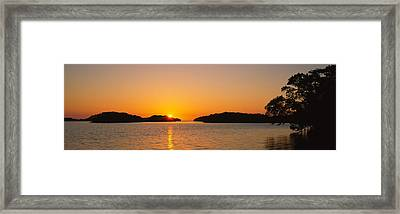Refection Of Sun In Water, Everglades Framed Print by Panoramic Images
