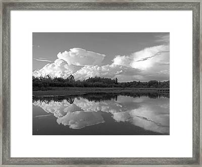 Reflecting Clouds Framed Print