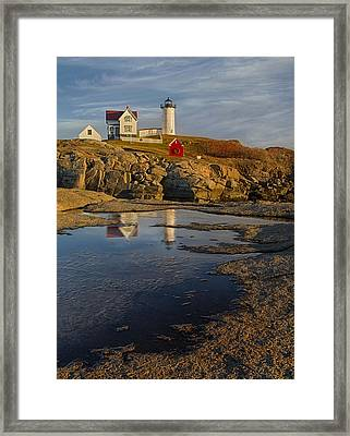 Reflecting On Nubble Lighthouse Framed Print