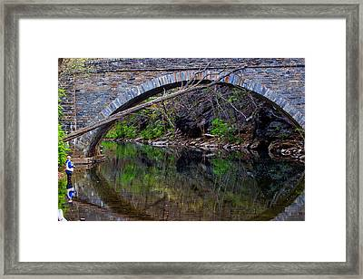 Reflecting While Fishing Framed Print