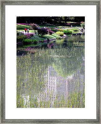 Reflection And Movement Framed Print by Menachem Ganon
