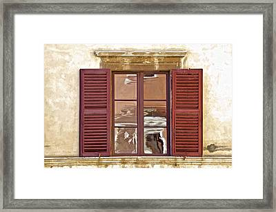 Reflection In A Window Of Tuscany Framed Print
