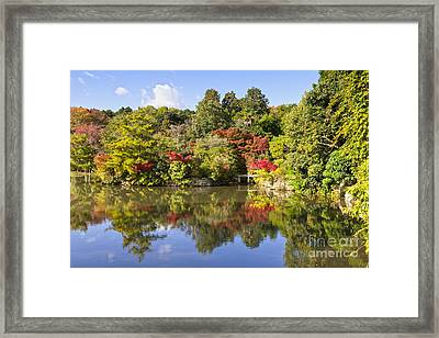 Reflection In Kyoyochi Pond In Autumn Ryoan-ji Kyoto Framed Print by Colin and Linda McKie