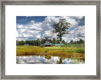 Reflection Of A Farm House Framed Print by Kathy Baccari