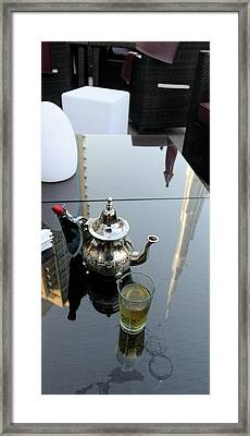 Reflection Of A Tower On A Table Framed Print