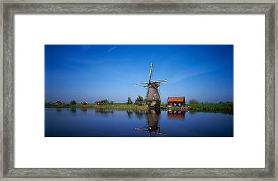 Reflection Of A Traditional Windmill Framed Print