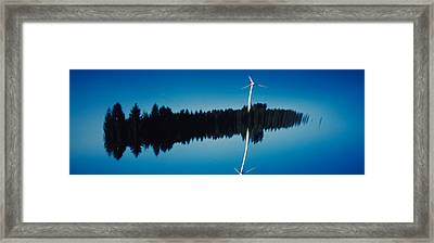 Reflection Of A Wind Turbine And Trees Framed Print