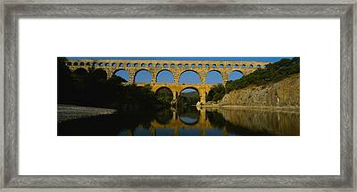 Reflection Of An Arch Bridge Framed Print by Panoramic Images