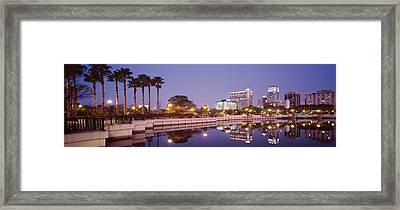 Reflection Of Buildings In The Lake Framed Print by Panoramic Images