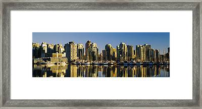 Reflection Of Buildings In Water, False Framed Print