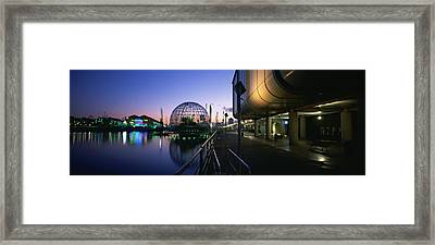 Reflection Of Buildings In Water, The Framed Print by Panoramic Images