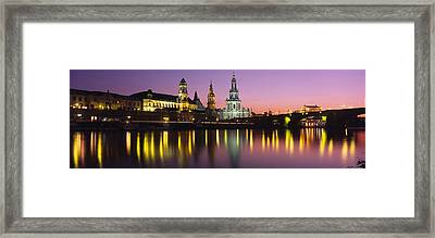 Reflection Of Buildings On Water At Framed Print by Panoramic Images