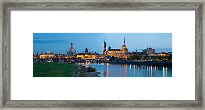 Reflection Of Buildings On Water Framed Print by Panoramic Images