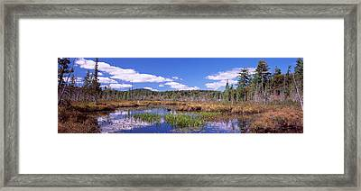Reflection Of Clouds In Water, Raquette Framed Print