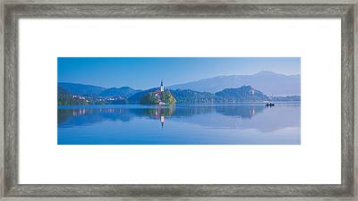 Reflection Of Mountains And Buildings Framed Print