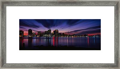 Reflection Of Skyscrapers On Water Framed Print by Panoramic Images