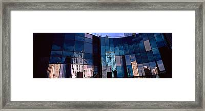 Reflection Of Skyscrapers Framed Print