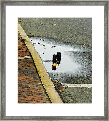 Reflection Of Traffic Light In Street Puddle Framed Print by Gary Slawsky