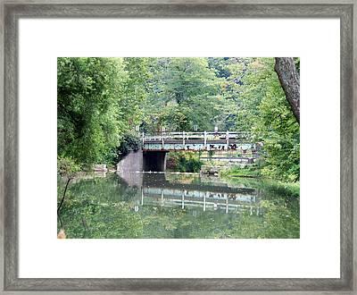 Reflections Of A Bridge Framed Print by Adam L