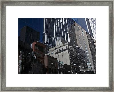 Reflections Of A City Framed Print by Karol Livote