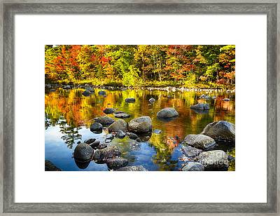 Reflections Of Autumn Foliage In A River Framed Print