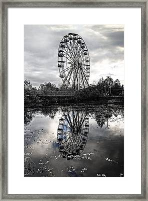 Reflections Of The Wheel Framed Print by Andy Crawford