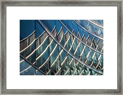 Reflections On Building Windows Framed Print