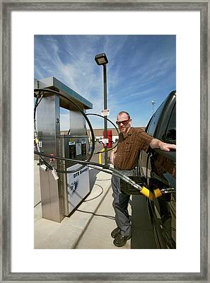Refuelling A Natural Gas Vehicle Framed Print by Jim West