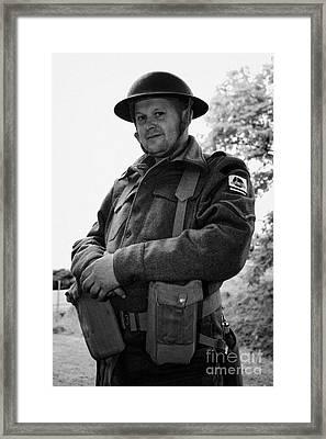 reinactor in dress of london irish rifles world war 2 WW2 uniform at Grey Point Fort Helens Bay Coun Framed Print by Joe Fox