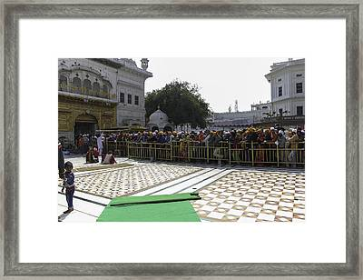Releasing A Batch Of Devotees Inside The Golden Temple In Amritsar Framed Print by Ashish Agarwal