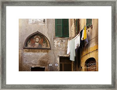 Religious Icon And Laundry Framed Print