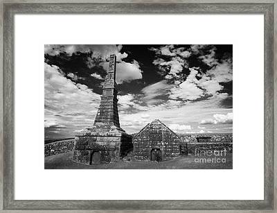remains of high stone celtic cross on O'Scally monument rock cashel ireland Framed Print