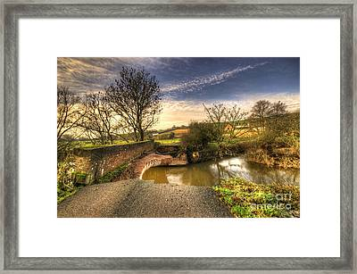 Remains Of The Bridge  Framed Print by Rob Hawkins