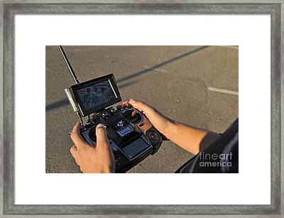 Remote Control And Video Monitor Framed Print by Sami Sarkis
