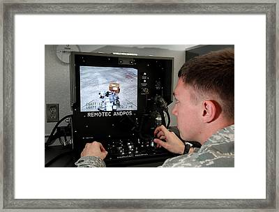 Remote Controlled Bomb Disposal Framed Print by Us Air Force/rey Ramon
