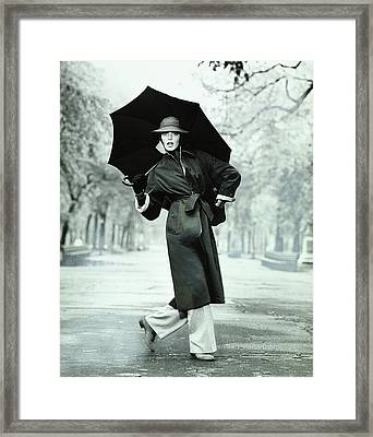 Rene Russo Wearing A Coat And Trousers Framed Print