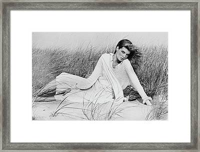 Rene Russo Wearing A Sweater On Sand Dunes Framed Print by Francesco Scavullo